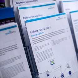 Several customer success stories prints in magazine rack