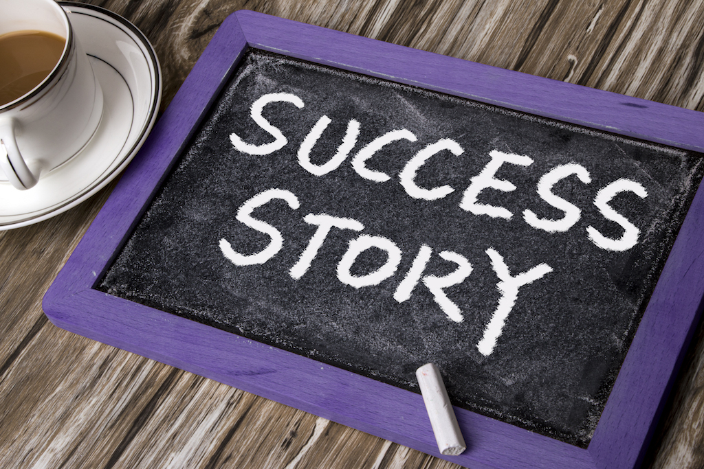 success story handwritten on blackboard